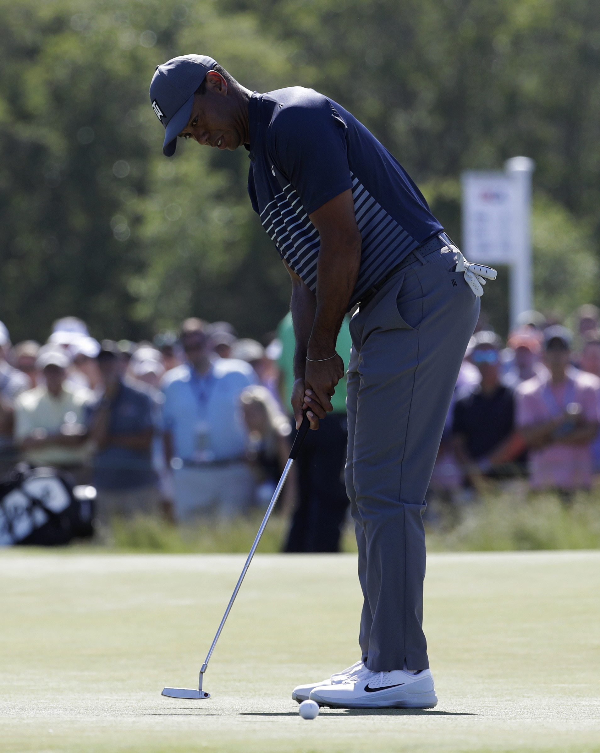 a 7 and a 78  ugly numbers for tiger woods in us open